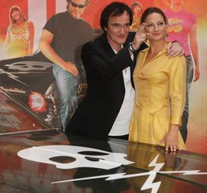 """Image Gallery: Concept Cars """"Death Proof"""" director Quentin Tarantino and star Zoe Bell stand beside Stuntman Mike's 1970 Chevy Nova at the movie's Berlin premiere in 2007. See more concept car pictures."""