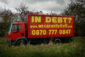 Debt is an international problem, as this United Kingdom ad reveals. Before you call that number, though, you might want to read the rest of this article.