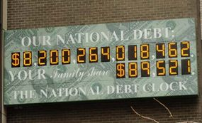 The National Debt Clock at 1133 Avenue of the Americas and 44th Street, in Midtown Manhattan, New York, shows the total US government debt (top) and the calculated amount per US family as of March 26, 2006.