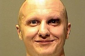 Does he look insane? Picture of Jared Lee Loughner after his arrest for the shooting spree in Tucson, Ariz.; U.S. Rep. Gabrielle Giffords was among the victims. Loughner, who was diagnosed with schizophrenia was sentenced to life without parole. See more criminal pictures.