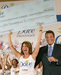 Showing off her prize-winning axillae (with Chuck Woolery) is Nikki Bohannon at Dove Deodorant's 2002 Most Beautiful Underarms contest.