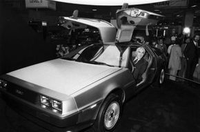 John DeLorean, founder of the DeLorean company, poses in a DMC-12. See more pictures of exotic cars.