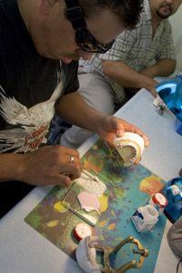 Dental technicians make crowns in a lab in Algodones, Mexico.