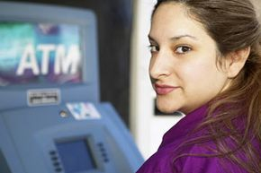 Is she making a mistake by using that ATM to make a deposit? See more money scam pictures.