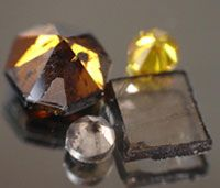 Photo courtesy Carnegie Institute of Washington                              Orange and yellow synthetic diamonds like these are less expensive than colored natural diamonds, which are rare.