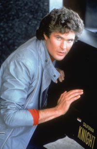 """David Hasselhoff (as Michael Knight) poses with K.I.T.T., the high-tech star of """"Knight Rider."""" See more exotic car pictures."""