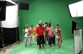 """Filmmakers use blue and green screens for shots that will be replaced with digital effects. Rapper T-Pain films his video for """"Can't Believe It"""" on a green screen."""