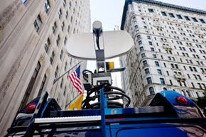The satellite dishes you see on news vans allow near real-time reporting.