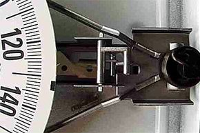 You can see the spring (right) and the spring plate housed inside this traditional bathroom scale.