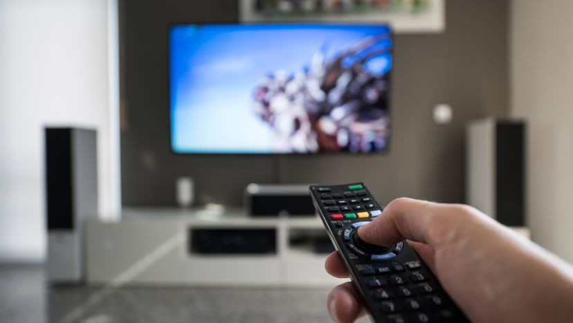 A man is switching through digital television channels