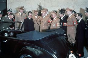 Adolf Hitler and other Nazi Officials admiring Hitler's 50th birthday present -- a Volkswagen convertible.