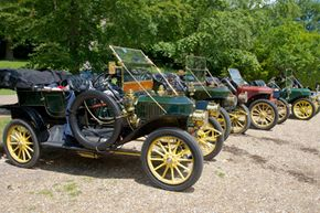 Steam-powered cars, like these vintage Stanley Steamers, are good examples of an external combustion engine being used to power an automobile.