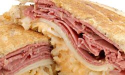 A traditional Reuben is stacked high with corned beef and sauerkraut.