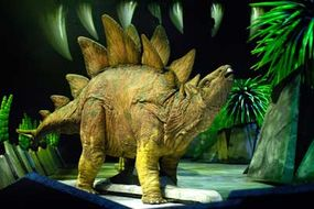 Dinosaurs, such as this animatronic stegosaurus shown in Walking with the Dinosaurs, had an upright gait. They held their bodies up over their legs.