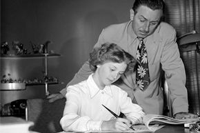 """Unlike Adriana Caselotti, Kathryn Beaumont (pictured here) probably isn't worried about revealing her """"secret identity"""" as she signs a contract under Walt Disney's watchful eye."""
