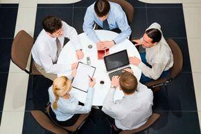 Executives collaborate to create a plan.