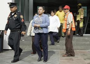 To practice your plan, hold a disaster drill like this earthquake evacuation drill staged in Mexico City.