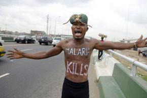 A malaria awareness activist in Lagos, Nigeria in April 2015