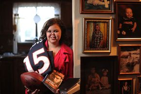 Sixteen-year-old Bailey Knaub poses with some of the items she received after a visit with Tim Tebow. Knaub has endured 73 surgeries since being diagnosed with Wegener's Granulomatosis at age 7.