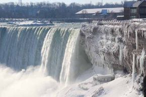 A view of the Niagara Falls frozen over due to the very cold weather in Ontario, Canada, January 9, 2014. Some people think this type of extreme cold disproves global warming.