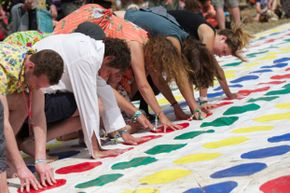 You could drag a regular Twister mat outside to play, but a few cans of spray paint and an outdoor space can save your indoor mat from wear and tear.