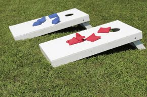 Cornhole -- also known as corn toss or bean bag toss -- takes up little space and can be played while still holding your plate of cake.