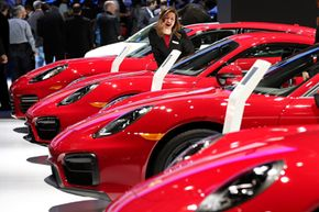 A brand new Porsche is expensive to insure -- but that has nothing to do with the red paint.