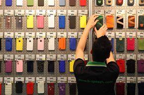 An employee arranges Apple iPhone case