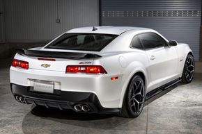 The 2014 Chevrolet Camaro Z/28 uses a dual exhaust system and large, three-inch-diameter pipes for low restriction. The optimized header and exhaust system improves torque and sound quality from the LS7 engine.