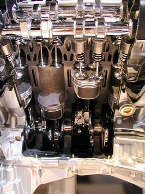 A cutaway dual overhead cam engine See more pictures of car engines.