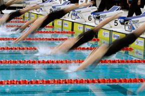 Competitors dive in at the start of the women's 50 meter butterfly at the Australian Swimming Championships in Sydney.