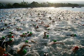 Swimmers churn the water as they begin the Ironman Triathlon World Championship race in Kailua-Kona, Hawaii.
