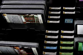 Another pleasant perk eventually added to set Dominion apart from some other card-based tabletop games: The box contains a ready-made filing system to keep all those cards tidy and accessible.