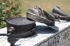 Items were bronzed for permanent outdoor display on pedestals bearing names of community members who served in each war.