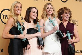(L-R) Actresses Joanne Froggatt, Sophie McShera, Laura Carmichael, and Phyllis Logan, winners of Outstanding Performance by an Ensemble in a Drama Series for 'Downton Abbey,' at the 21st annual Screen Actors Guild Awards in January 2015.