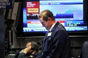 Traders work the floor of the New York Stock Exchange in June 2010, amid fears of a double-dip recession.