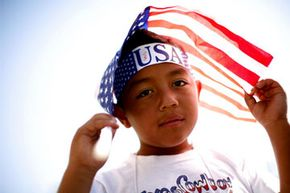 Undocumented youth could become legal U.S. citizens under the DREAM Act. See more pictures of the American flag.