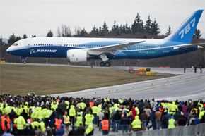 The Boeing 787 Dreamliner taxis in front of a crowd of Boeing employees before its long-awaited first flight on Dec. 15, 2009, at Paine Field in Everett, Wash. See more flight pictures.