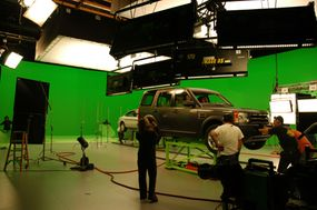 On-stage cars are suspended on air casters to make them easier to move and shoot around.