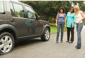 """Establishing shots, like this one of Hurricane Katrina survivors Leigh (Rochelle Aytes, L), Susan (Michael Hyatt, C) and Ivy (Taryn Manning, R) checking out their flat tire, give """"Drive"""" a sense of realism."""