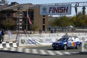 'Junior,' a 2006 Volkswagen Passat, heavily modified and robotized by a team from Stanford University, crosses the finish line during the 2004 DARPA Urban Challenge in Victorville, California. The cars had no drivers and weren't remote-controlled.