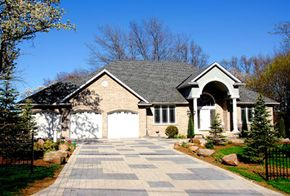 Brick driveways look great and are relatively inexpensive to maintain.