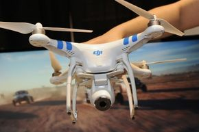 A DJI Innovations DJI Phantom 2 Vision aerial system drone was demonstrated during a media preview for International CES 2014.
