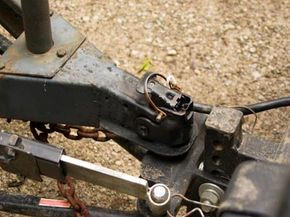 A trailer hitch receiver like this one helps people ferry trailers and other large items, but you need a drop hitch receiver to make sure your vehicle stays upright.