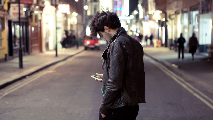 man with phone on busy street