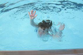 boy sinking in water