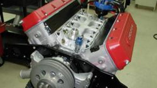 Why do some engines use a dry sump oil system?