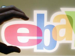 A visitor at the Trade Fair for Digital Marking in Düsseldorf, Germany, grabs the logo of Internet auction house eBay. Are organized retail crime groups grabbing profits from companies?