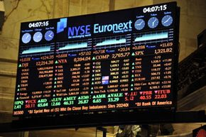 Most ETFs are tied to stock indexes, like these shown on an electronic board at the New York Stock Exchange. See more investing pictures.