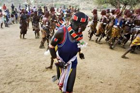The bride-to-be in the center is dancing during her wedding celebration in the Hamar tribe village of Unga Bayno in Turmi, Ethiopia. The dancing takes place in conjunction with a Bull Jumping Ceremony in which the groom must leap over the animal to prove he's worthy of marriage.